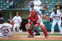 Pawtucket Red Sox catcher Matt Spring (47) waits for a throw as Reynaldo Rodriguez (23) slides in to score a run during a game against the Rochester Red Wings on July 1, 2015 at Frontier Field in Rochester, New York.  Umpire Sean Barber is seen in the background.  Rochester defeated Pawtucket 8-4.  (Mike Janes/Four Seam Images)