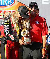 Feb 26, 2017; Chandler, AZ, USA; NHRA top fuel driver Leah Pritchett (left) celebrates with team owner Don Schumacher after winning the Arizona Nationals at Wild Horse Pass Motorsports Park. Mandatory Credit: Mark J. Rebilas-USA TODAY Sports