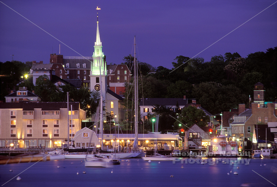 USA, Newport, RI - Night time view of Newport's waterfront taken from Goat Island.  Looking at the Viking hotel high on the hill, Trinity Church, and the Newport Harbor hotel on the waterfront.  Adjacent are the  wharfs of Bowen's Landing and the Aquidneck Lobster company  with the brick Seaman's Church Institute to the right..