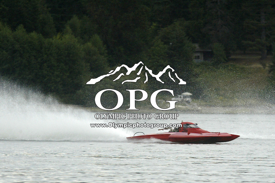 August 10, 2008 :  Kevin Eacret driving the E-36 Baker Equipment eight cylinder hydro races around turn one during heat 2 competition at the Silverdale Thunder Hydro races in Silverdale, Washington .