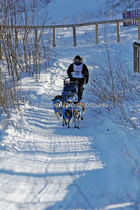 Saturday, February 24th, Knik, Alaska.  Jr. Iditarod musher Melissa Owens on the trail shortly after leaving the Knik start