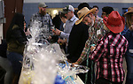 "Supporters Gary Yoakum and Debbie Lane check out the raffle at ""We Are Western"" event hosted by the Western Nevada College Foundation, in Carson City, Nev., on Friday, March 8, 2019. <br /> Photo by Cathleen Allison/Nevada Momentum"