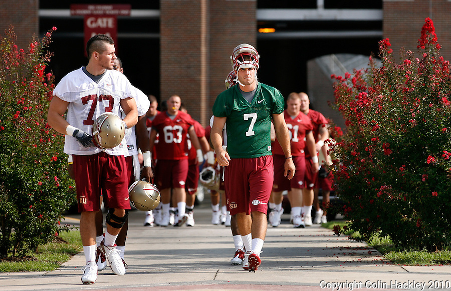 TALLAHASSEE, FL 8/5/10 FSU 080510 CH-Florida State's Christian Ponder, right, walks to to the field for the first day of practice Thursday in Tallahassee. .COLIN HACKLEY PHOTO