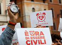 "Manifestazione a sostegno della legge sulle unioni civili in discussione nei prossimi giorni al Senato, a Roma, 23 gennaio 2016.<br /> A protester holds an alarm clock during demonstration in favor of civil unions rights, including gay couples, ahead of a parliamentary debate, in Rome, 23 January 2016. The sign reads ""It's time to be civil"". <br /> UPDATE IMAGES PRESS/Riccardo De Luca"