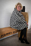 © Joel Goodman - 07973 332324 . 2 November 2013 . Chorlton Precinct (aka The Square ) Manchester , UK . Friends of Harry, actress and musician JACKIE TRENT , sits on the bench . A bench in memory of photographer Harry Goodwin is unveiled at Chorlton Precinct . The locally created carved wood design features two cameras , one a historic twin-lens reflex design and the other a modern 35mm design . Photo credit : Joel Goodman