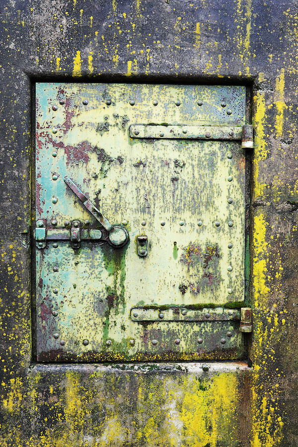 Closed rusty green steel door in concrete bunker window, Artillery Hill, Fort Worden State Park, Port Townsend, Washington, USA