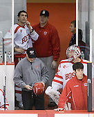 Max Nicastro (BU - 7), Larry Venis (BU - Senior Associate Head Athletic Trainer), Mike DiMella (BU - Equipment Manager), Adam Kraus (BU - 32), Patrick Walsh (BU - Team Manager) - The Boston University Terriers defeated the Merrimack College Warriors 6-4 (EN) on Saturday, January 16, 2010, at Agganis Arena in Boston, Massachusetts.