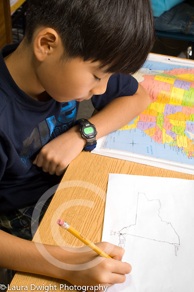 Grade 3 geography boy working with map