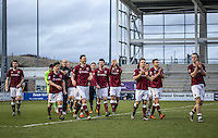 The Northampton players applaud the fans after their victory in the Sky Bet League 2 match between Northampton Town and Wycombe Wanderers at Sixfields Stadium, Northampton, England on the 20th February 2016. Photo by Liam McAvoy.