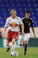 John Wolyniec (15) of the New York Red Bulls is chased by Colin Clark (11)  of the Colorado Rapids. The New York Red Bulls defeated the Colorado Rapids 3-0 during a U. S. Open qualifier match at Red Bull Arena in Harrison, NJ, on May 26, 2010.