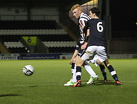 Conor Newton being closely watched by Chris Snee in the St Mirren v Dundee Clydesdale Bank Scottish Premier League Under 20 match played at St Mirren Park, Paisley on 14.1.13.