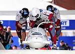 22 November 2009:  Janis Minins, piloting the Latvia 1 bobsled, leads his 4-man team to a 5th place finish at the FIBT World Cup competition, in Lake Placid, New York, USA. Mandatory Credit: Ed Wolfstein Photo