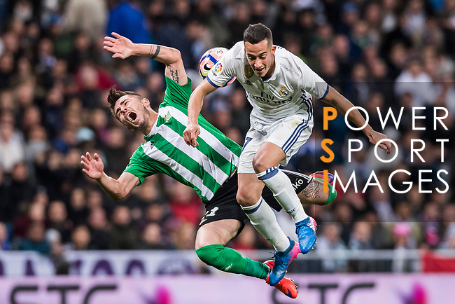 Lucas Vazquez (r) of Real Madrid fights for the ball with Alin Tosca of Real Betis during their La Liga match between Real Madrid and Real Betis at the Santiago Bernabeu Stadium on 12 March 2017 in Madrid, Spain. Photo by Diego Gonzalez Souto / Power Sport Images