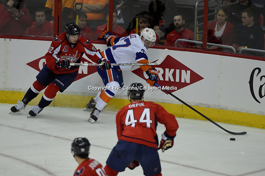 April 15, 2015 - Washington D.C., U.S. - New York Islanders center Anders Lee (27) and Washington Capitals center Evgeny Kuznetsov (92) battle in the corner for the puck  during game 1 of the  NHL Eastern Conference Quarter finals between the New York Islanders and the Washington Capitals held at the Verizon Center in Washington DC. The Islanders defeat the Capitals  4-1 in regulation time. Eric Canha/CSM