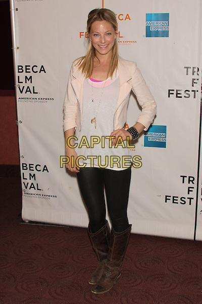 "ANASTASIA GRIFFIN.The 2010 Tribeca Film Festival Premiere of ""Open House"" at the Clearview Chelsea Theater, New York, NY, USA..April 24th, 2010.full length white cream top black leggings brown boots hand on hip pink jacket.CAP/LNC/TOM.©TOM/LNC/Capital Pictures."