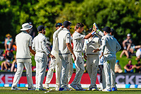 Trent Boult of the Black Caps celebrates the wicket of Alastair Cook of England with team mates during Day 3 of the Second International Cricket Test match, New Zealand V England, Hagley Oval, Christchurch, New Zealand, 1st April 2018.Copyright photo: John Davidson / www.photosport.nz