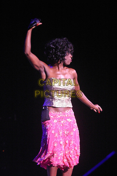 HEATHER SMALL .M People .plays Nottingham Arena..UK, United Kingdom..Ref: JEZ.30th September 2005.3/4 length M People live on stage performing gig sing singing mpeople m-people holding microphone pastel pink strapless boobtube silk satin top bright sequinned skirt curls curly waves tousled hair.www.capitalpictures.com.sales@capitalpictures.com.©Capital Pictures.