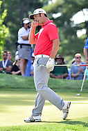 Bethesda, MD - June 26, 2016: John Rahm is upset after just missing a chip shot on the seventeenth hole for par during Final Round of play at the Quicken Loans National Tournament at the Congressional Country Club in Bethesda, MD, June 26, 2016. (Photo by Philip Peters/Media Images International)