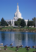 The spire of the Mormon temple in Idaho Falls, Idaho is visible beyond a reflecting pool inhabited by geese. ham Young in 1847. Their headquarters are in Salt Lake City, Utah. Idaho Falls, Idaho.