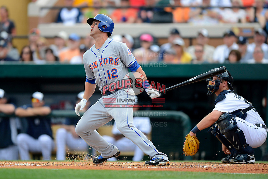 New York Mets infielder Brandon Hicks #12 hits a home run during a Spring Training game against the Detroit Tigers at Joker Marchant Stadium on March 11, 2013 in Lakeland, Florida.  New York defeated Detroit 11-0.  (Mike Janes/Four Seam Images)