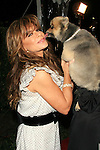 Paula Abdul is kissed by a dog at the IDA (In Defense of Animals) benefit concert at Paramount Studios in Los Angeles, California on February 17, 2007. Photo by Nina Prommer/Milestone Photo.