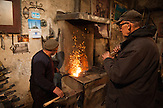 A Roma blacksmith worker in the Terzi Mahalla in the town of Prizren