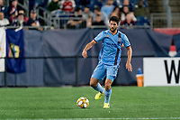 FOXBOROUGH, MA - SEPTEMBER 29: Eric Miller #5 of New York City FC passes the ball during a game between New York City FC and New England Revolution at Gillette Stadium on September 29, 2019 in Foxborough, Massachusetts.