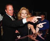 Frank and Kathie Lee Gifford tour the controversial new exhibit on sweatshops at the Smithsonian Museum of American History in Washington, D.C. on April 21, 1998..Credit: Ron Sachs / CNP