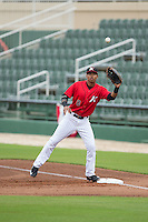 Kannapolis Intimidators first baseman Tyler Williams (8) stretches for a throw during the game against the Hickory Crawdads at CMC-Northeast Stadium on April 17, 2015 in Kannapolis, North Carolina.  The Crawdads defeated the Intimidators 9-5 in game one of a double-header.  (Brian Westerholt/Four Seam Images)