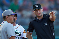 Umpire Dane Poncsak goes over the grounds rules with Winston-Salem Dash manager Justin Jirschele (9) prior to the game against the Down East Wood Ducks at Grainger Stadium Field on May 17, 2019 in Kinston, North Carolina. The Dash defeated the Wood Ducks 8-2. (Brian Westerholt/Four Seam Images)