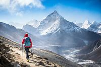 Hiking on Cho La Pass with a view of Ama Dablam, Nepal
