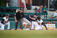 Jacksonville Suns left fielder Austin Dean (3) slides in safely as third baseman Tom Belza (11) fields a throw with umpire Travis Godec and third base coach Rich Arena (14) looking on during a game against the Mobile BayBears on April 18, 2016 at The Baseball Grounds in Jacksonville, Florida.  Mobile defeated Jacksonville 11-6.  (Mike Janes/Four Seam Images)