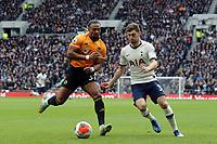 Ben Davies of Tottenham Hotspur and Adama Traore of Wolverhampton Wanderers during Tottenham Hotspur vs Wolverhampton Wanderers, Premier League Football at Tottenham Hotspur Stadium on 1st March 2020