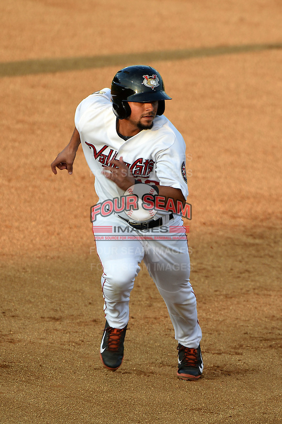 Tri-City ValleyCats second baseman Alex Hernandez (13) running the bases during a game against the Batavia Muckdogs on August 2, 2014 at Joseph L. Bruno Stadium in Troy, New  York.  Tri-City defeated Batavia 8-4.  (Mike Janes/Four Seam Images)