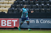 Adebayo Akinfenwa of Wycombe Wanderers celebrates his goal during the Sky Bet League 2 match between Notts County and Wycombe Wanderers at Meadow Lane, Nottingham, England on 10 December 2016. Photo by Andy Rowland.