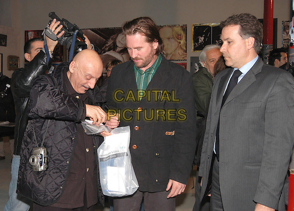 VAL KILMER & ALBORZI ALI.visiting Studio Chia Gallery in Rome which is showing pictures from the film Wonderland and their own collages.19 February 2004.www.capitalpictures.com.sales@capitalpictures.com.© Capital Pictures.