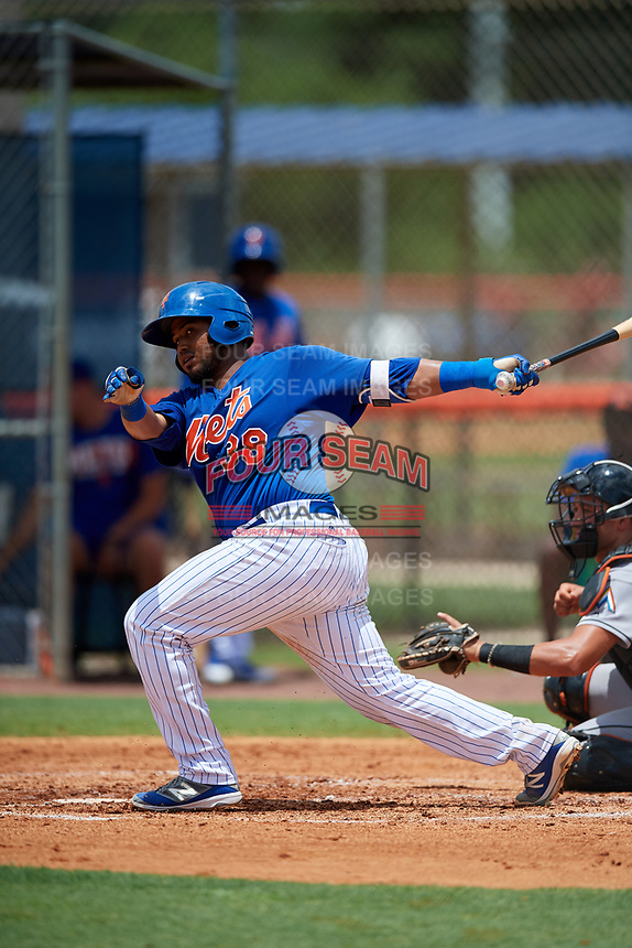 GCL Mets catcher Jose Mena (38) follows through on a swing during a game against the GCL Marlins on August 3, 2018 at St. Lucie Sports Complex in Port St. Lucie, Florida.  GCL Mets defeated GCL Marlins 3-2.  (Mike Janes/Four Seam Images)