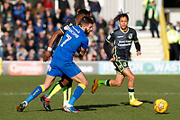 George Francomb of AFC Wimbledon gets to grips with Marc Bola of Bristol Rovers (on loan from Arsenal) during the Sky Bet League 1 match between AFC Wimbledon and Bristol Rovers at the Cherry Red Records Stadium, Kingston, England on 17 February 2018. Photo by Carlton Myrie.