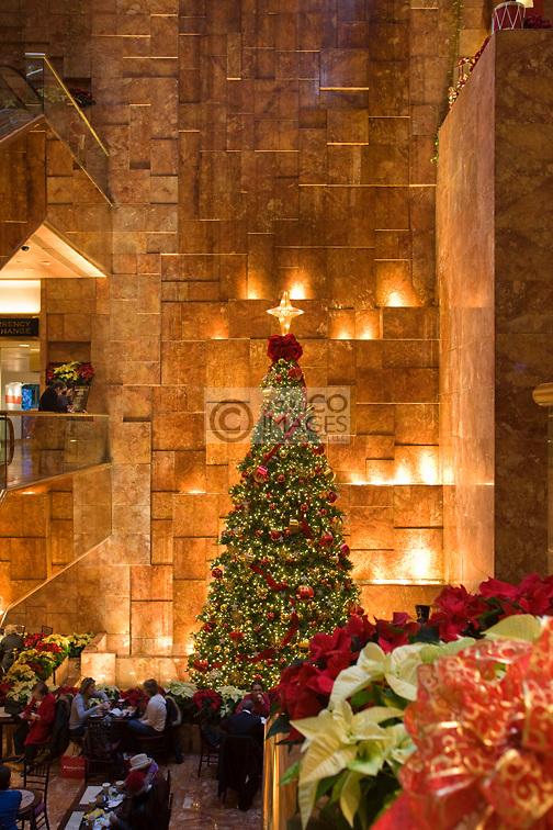 CHRISTMAS TREE LIGHTS ATRIUM TRUMP TOWER SHOPPING MALL FIFTH AVENUE MANHATTAN NEW YORK CITY USA