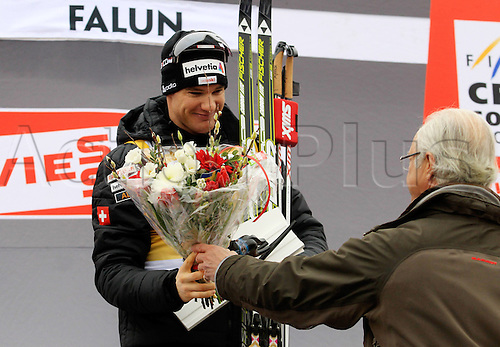 17 03 2012   Falun Sweden Ski Nordic Cross-country skiing FIS World Cup 15km Mass start  classic Award Ceremony Picture shows Dario Cologna SUI and Koenig Carl XVI Gustaf NOR