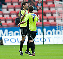 Stranraer's Martin Grehan is congratulated after he deflected Mark Corcoran's (11) shot into the net for their first goal.