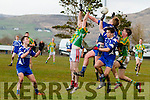 Keep your eyes on the ball - Lispole's kick out soars over the heads of Lispole's Kieran O'Sullivan & Mike Jim Fitzgerald and Renards Mark Sugrue & Cian O'Leary.