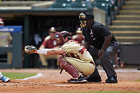 Florida State Seminoles catcher Cal Raleigh (35) frames a pitch as home plate umpire Troy Fullwood looks on during the game against the North Carolina Tar Heels in the 2017 ACC Baseball Championship Game at Louisville Slugger Field on May 28, 2017 in Louisville, Kentucky. The Seminoles defeated the Tar Heels 7-3. (Brian Westerholt/Four Seam Images)