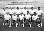 FTB 1984 Photoday<br /> Team Coaches<br /> FTB 700 ii 4<br /> <br /> Standing Row: Chuck Stiggins, Mel Olsen, Lance Reynolds, Mike Holmgren, Ken Schmidt, Jim Paronto<br /> Kneeling Row: Tom Ramage, Dick Felt, LaVell Edwards, Roger French, Norm Chow<br /> <br /> Photo by Mark Philbrick/BYU<br /> <br /> &copy; BYU PHOTO 2009<br /> All Rights Reserved<br /> photo@byu.edu  (801)422-7322