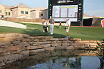 Dubai World Championship Golf. Earth Course,.Jumeirah Golf Estate, Dubai, U.A.E...Rory McIlroy drops a shot after playing his thirdy shot into the water the 18th green during the third round of the Dubai World Golf championship..Photo: Fran Caffrey/www.golffile.ie...