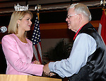 Dan Irving/The Holland Sentinel.Holland Mayor Al McGeehan, right, greets Miss America Kirsten Haglund during the Tulip Time Festival Luncheon Wednesday at the Hope College Dow Center..(5/7/08)