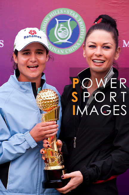 HAIKOU, CHINA - OCTOBER 31:  Lorena Ochoa (L) of Mexico poses with Hollywood actress Catherine Zeta-Jones after winning the Mission Hills Start Trophy at Mission Hills Resort on October 31, 2010 in Haikou, China.  The Mission Hills Star Trophy is Asia's leading leisure liflestyle event and features Hollywood celebrities and international golf stars. Photo by Victor Fraile / The Power of Sport Images
