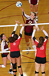 SIOUX FALLS, SD - OCTOBER 25:  Maggie DeJong #17 from Roosevelt tries to get a kill past Emily Herrera #6 and an unidentified defender from Rapid City Central in the third game of their match Friday night at Roosevelt. (Photo by Dave Eggen/Inertia)