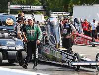 Aug. 2, 2014; Kent, WA, USA; NHRA funny car driver John Force stands alongside the top fuel dragster of daughter Brittany Force and team during qualifying for the Northwest Nationals at Pacific Raceways. Mandatory Credit: Mark J. Rebilas-
