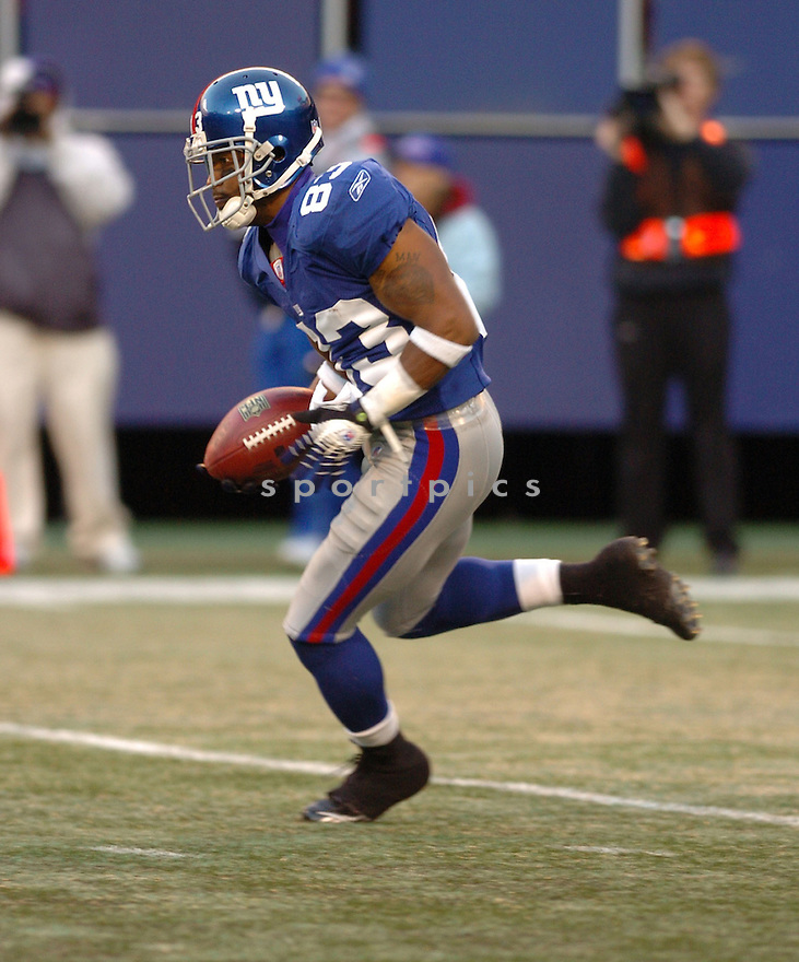 SINORICE MOSS, of the New York Giants during their game against the New Orleans Saints on December 24, 2006 in NJ...Saints win 30-7..Tomasso DeRosa / SportPics